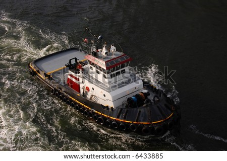 Tugboat in the Caribbean approaching cruise ship - see more in portfolio - stock photo