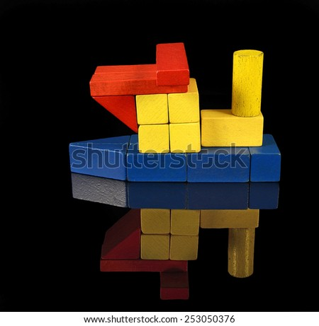 Tugboat of wooden blocks, traditional toy on black background - stock photo