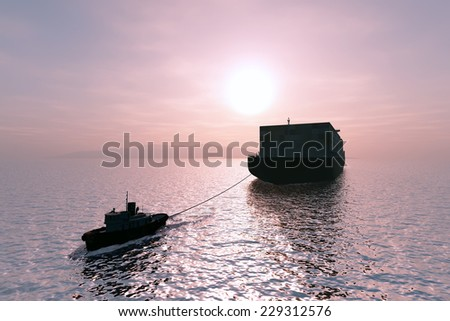 Tugboat pulling a cargo tanker. - stock photo