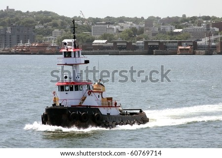 Tugboat with Staten Island in background - stock photo