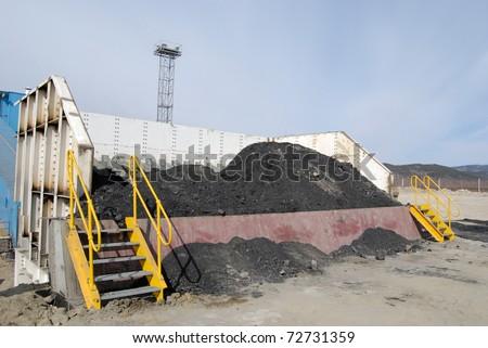 TUGNUI, RUSSIA - APRIL 2: The opening of Tugnuiskaya coal-preparation plant. A place where haulers unload coal, April, 2, 2008 in Tugnui, Buryatia, Russia. - stock photo