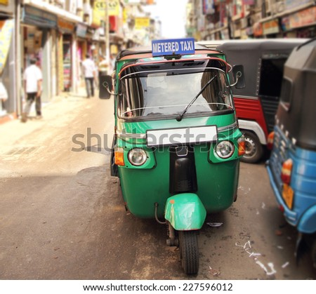 tuk tuk taxi on the street - stock photo