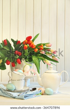 Tulips and colored eggs for Easter - stock photo