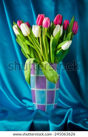 Tulips Flowers in a Pastel Vase on Silk Background - stock photo