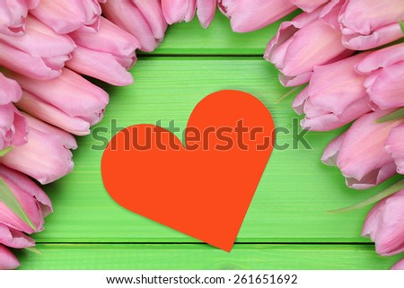 Tulips flowers with heart as symbol of love on Valentine's day with copyspace for your own text - stock photo