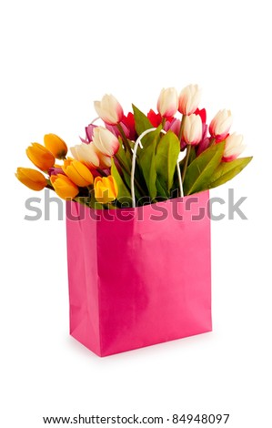 Tulips in the bag isolated on white - stock photo