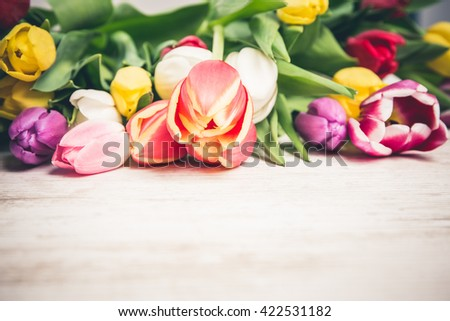 Tulips on a wooden table