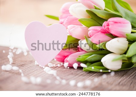 tulips with a heart - stock photo