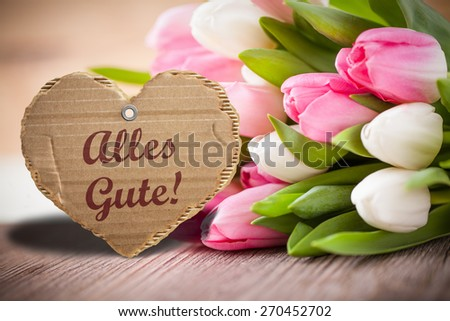 """tulips with message saying """"Best wishes!"""" in German - stock photo"""