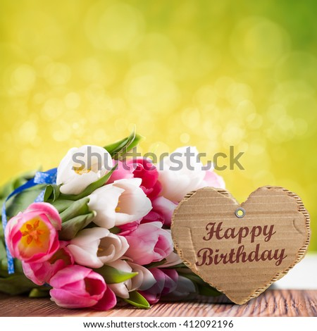 """tulips with message saying """"Happy Birthday"""" - stock photo"""