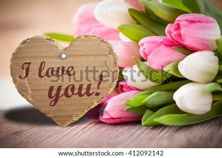 """tulips with message saying """"I love you!"""" - stock photo"""