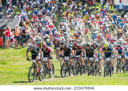 TULLINGE, STOCKHOLM - JUNE 8: After the start of the Lidaloop mountainbike race 2014 with a leader group. June 8, 2014 in Stockholm, Sweden. One of the biggest MTB races in sweden. - stock photo