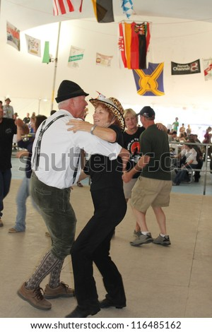 TULSA, OK - OCT 20: Oktoberfest goers enjoy dancing at Oktoberfest in TULSA, OK, on October 20, 2012 in TULSA, OK. Tulsa is the origin of the first Oktoberfest Chicken Dance in the United States. - stock photo