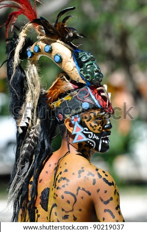 TULUM, MEXICO - FEBRUARY 17: Mayan Warrior in traditional dress, performs an ancient ritual dance on February 17, 2010 in Tulum, Mexico