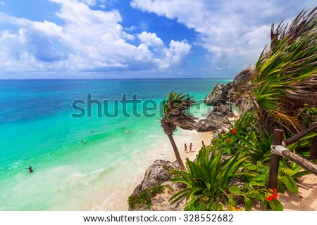 TULUM, MEXICO - JULY 15, 2011: Idyllic beach of Tulum with people swiming in caribbean sea, Quintana Roo, Mexico. Tulum is an archaeological site in the Riviera Maya, Yucatan. - stock photo