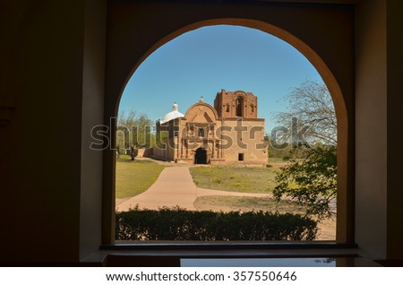 Tumacacori Mission framed through a window of another building at Tumacacori National Historic Park, USA - stock photo