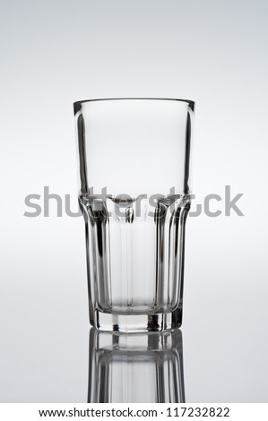 Tumbler, Cocktail glass on gradient background, studio shot, with reflection - stock photo