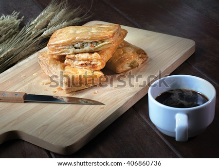 Tuna pie and coffee on wooden block /Image Select focus and Still life style