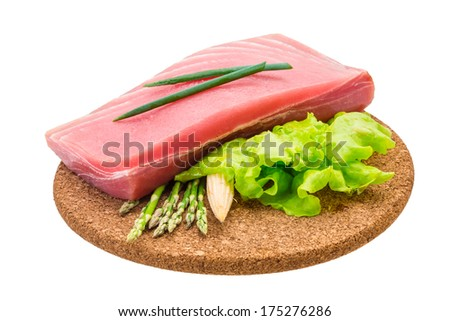 Tuna raw steak with asparagus and salad - stock photo