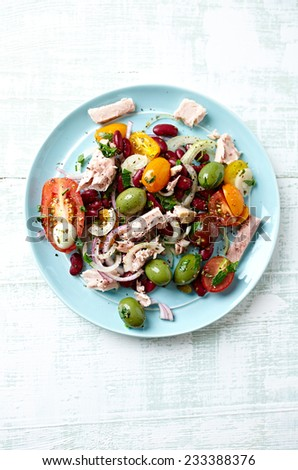 Tuna salad with cherry tomatoes, olives and beans - stock photo
