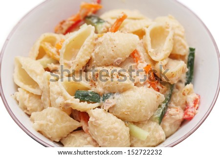 Tuna shell pasta in bowl over white background. - stock photo