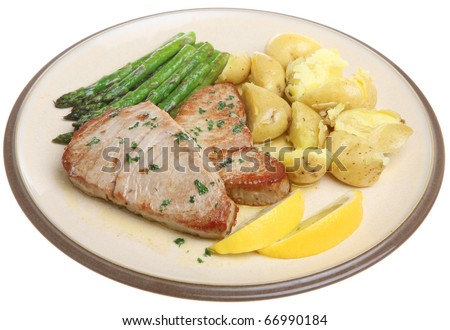 Tuna steaks with new potatoes and asparagus.