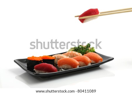 Tuna Sushi with chopsticks isolated on white  background