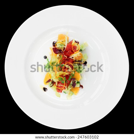 Tuna tartar with cucumber and orange isolated on black background - stock photo