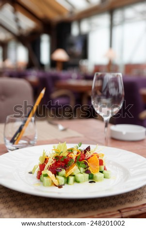 Tuna tartar with cucumber and orange on restaurant table