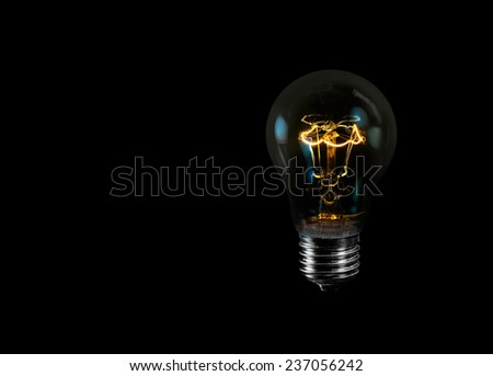 tungsten light bulb isolated on black background  - stock photo