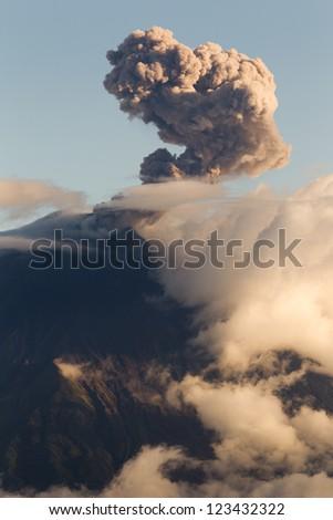 TUNGURAHUA VOLCANO EXPLOSION AT SUNSET, ECUADOR, SOUTH AMERICA  - stock photo