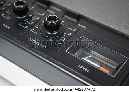 Tuning knobs of old retro stereo cassette recorder. Selective focus on Recording - stock photo