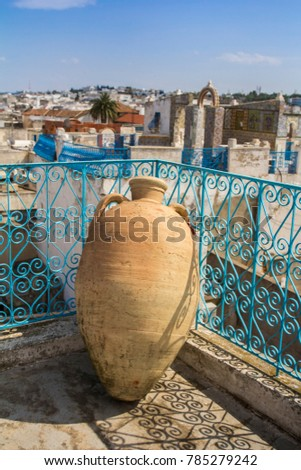 TUNIS, TUNISIA - August 29, 2017: Old vases on the roof of a warehouse in the medina