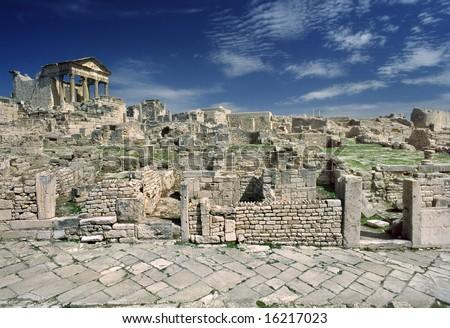 Tunisia. Ancient Dougga. There is the Capitolium on left - stock photo