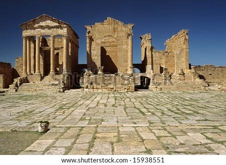 Tunisia. Ancient Sufetula (present day Sbeitla). Forum and three temples forming the capitolium. - stock photo