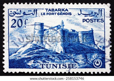 TUNISIA - CIRCA 1954: a stamp printed in Tunisia shows Genoese Fort, Tabarka, circa 1954 - stock photo
