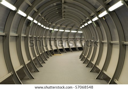 Tunnel made of metal construction with neon lights, Airport of Schwechat, Austria - stock photo
