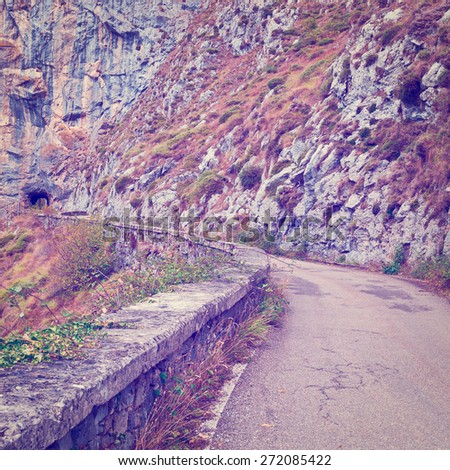 Tunnel on the Winding Asphalt Road in the Cantabrian Mountains, Spain, Instagram Effect - stock photo