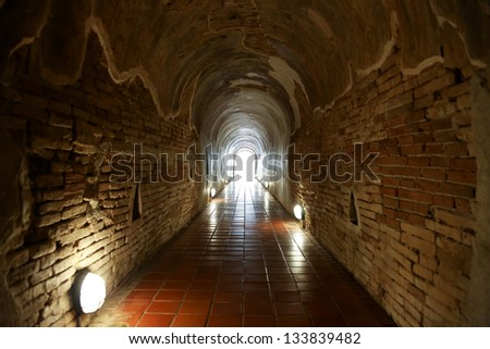 Tunnel with light coming from the exit - stock photo