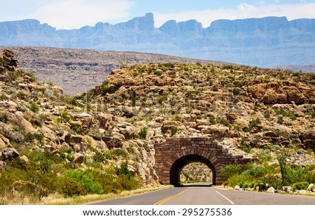 Tunnel with Mountains at Big Bend National Park - stock photo
