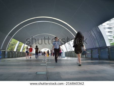 Tunnel with pedestrians - stock photo