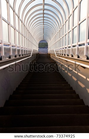 Tunnel with stairs leading down - stock photo