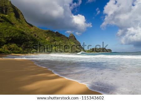 Tunnels beach at Kauai with Bali Hai in the background - stock photo