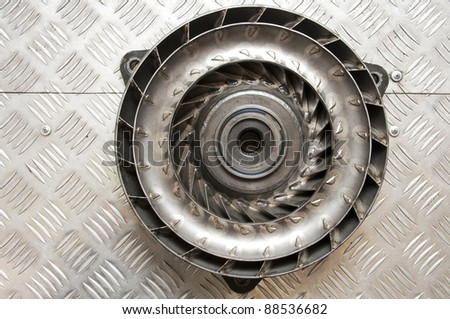 Turbine part on metal floor - stock photo