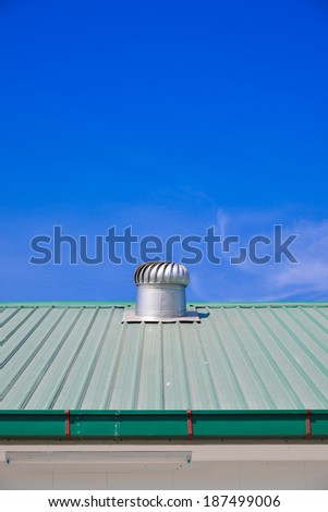Turbine roof ventilation system on top of metal sheet roof  - stock photo