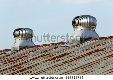 Turbine roof ventilation system on top of the roof - stock photo