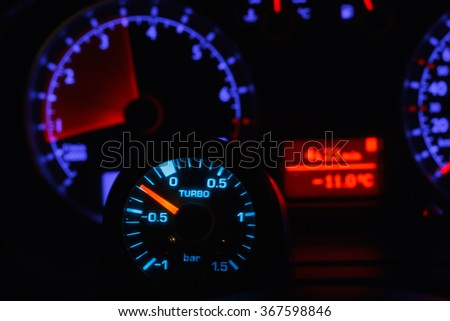 Turbo boost gauge and blurry unfocused speedometer