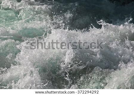 Turbulent river water - stock photo