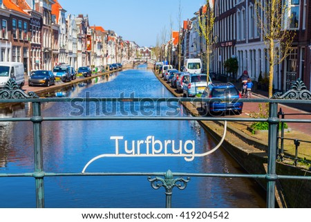 Turfmarkt canal in Gouda, Netherlands, seen from the Turfbrug - stock photo