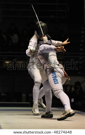 TURIN, FEB 7: Women Foil World Cup,  Elisa Di Francisca fight team tournament final match Italy vs Russia on February 7, 2010 in Turin, Italy. - stock photo